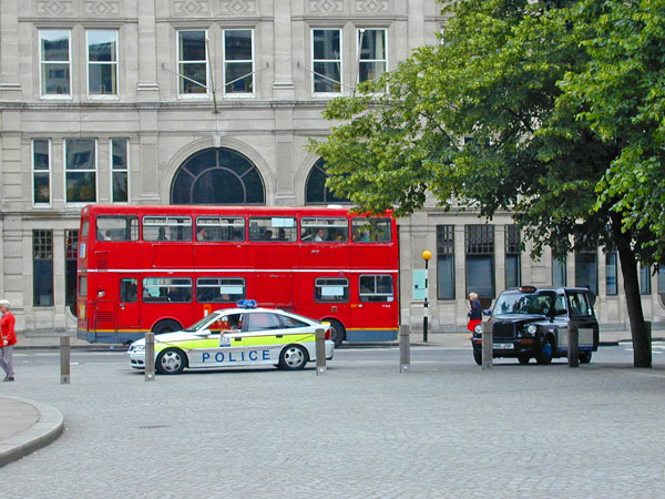 British bus, police car and taxi